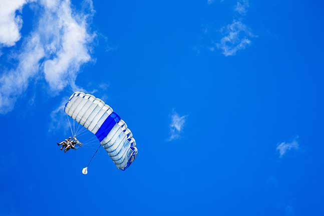Skydiver flying with Parachute opened